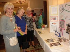 Carol Oeltjenbruns, Sue Krocheski and guest admire history
