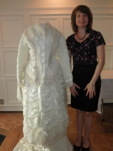 Speaker Jayne Becker with Victorian wedding dress.